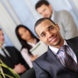 Confident african-american businessman in office — Stock Photo