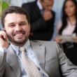 Laughing executive businessman on the phone — Stock Photo