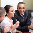 Stock Photo: Diverse business group laughing at the meeting