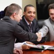 Young african-american businessman is happy about making a deal — Stock Photo