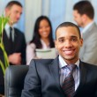 Happy african-american businessman in office — Stock Photo #20506335