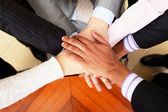 Image of business hands on top of each other — Stock Photo