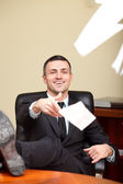 Relaxed businessman throwing documents away. — Stock Photo