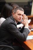 Mature businessman at the meeting — Stock Photo