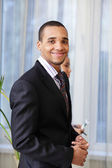 Happy African-American young businessman — Stock Photo