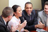 Diverse business group laughing at the meeting — Stockfoto