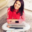 Stock Photo: Young woman with laptop