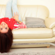 Portrait of a young beautiful woman on sofa — Stock Photo #25729161