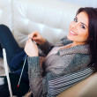 Portrait of a young beautiful woman on sofa — Stock Photo #25729467