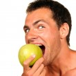 Young man eating apple — Stock Photo #26061171
