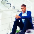 Mature pensive man sitting on stairs — Stock Photo