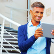 Stock Photo: Handsome musing electronic tablet computer