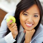 Asian businesswoman holding an apple — Stock Photo