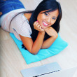 Young beautiful asian woman sitting on the floor with laptop — Stock Photo
