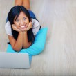 Young beautiful asian woman sitting on the floor with laptop — Stock Photo #30024035