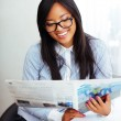 Asian businesswoman reading newspaper — Stock Photo #30024069