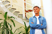 Young handsome casual man at home — Stock Photo