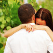 Young couple in love hugging in the park — Stock Photo #31193523