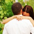 Young couple in love hugging in the park — Stock Photo