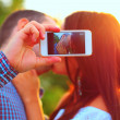 Couple taking self-portrait photos — Stock Photo #31193561