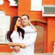 Happy couple standing in front of new home — Stock Photo