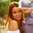 Couple taking self-portrait photos — Stock Photo