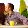 Romantic couple kissing in cafe — Stock Photo #31193779