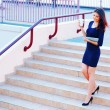 Businesswoman going down the stairs — Stock Photo