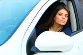 Young beautiful woman in a modern white car — Stock Photo