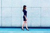 Young attractive businesswoman walking — Stock Photo