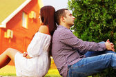 Couple resting an the lawn — Stock Photo