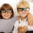 Brother and sister watching 3D movie — ストック写真