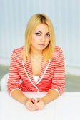 Woman in red jacket sitting at the table — Stock Photo