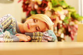 Sleeping woman on table — Foto de Stock