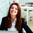 Businesswoman laughing in office — Stock Photo