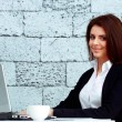 Businesswoman sitting at the table in office — Stock Photo
