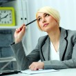Businesswoman sitting at the table — Stock Photo