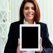 Businesswoman showing display of a tablet computer — Stock Photo #37580425