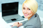 Young smiling businesswoman in office — Stock Photo