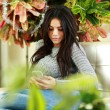 Young beautiful woman using smartphone — Stock Photo