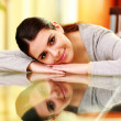 Woman lying on the table at home — Stock Photo #38412931