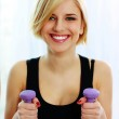 Woman holding dumbbells — Stock Photo
