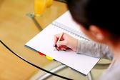 Female hand writing notes — Foto de Stock