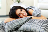 Woman lying on the floor with pillows — Stock Photo