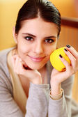 Woman holding yellow apple — Stock Photo