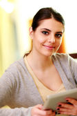 Woman holding tablet computer — Stock Photo