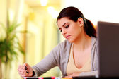 Happy woman writing notes — Stock Photo