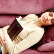 Woman sleeping with book — Stock Photo