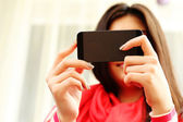 Woman holding smartphone — Stock Photo