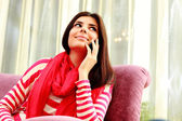 Thoughtful woman talking on the phone — Stock Photo